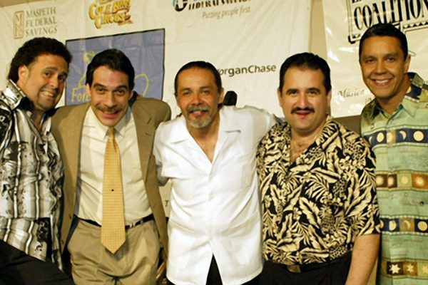 "left to right: violinist - Alfredo de la Fé, flautist -Dave Valentin, percussionist - Angel Rodriguez, trombonist - Demetrios Kastaris, singer - Herman Olivera, ""Homenaje a Mongo Santamaria"" (Homage to Mongo Santamaria) Concert, June 16, 2003, Seuffert Bandshell, Woodhaven Queens, New York, photo credit Jerry Lacay."