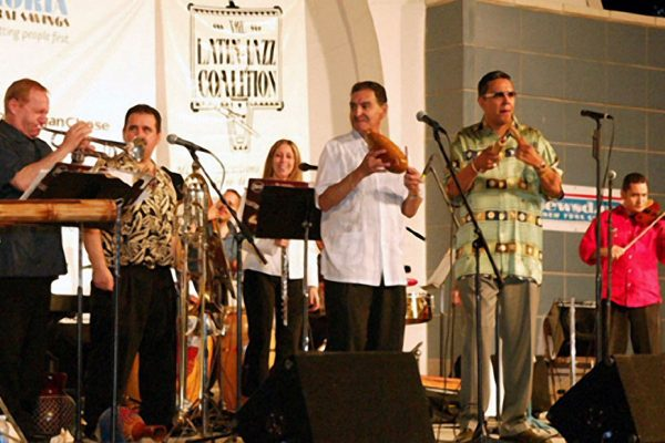 left to right: Steve Gluzband wails on his trumpet solo, Demetrios Kastaris, Solo Rodriguez, Connie Grossman, Hiram Remón, Herman Olivera, Alí Bello, June 16, 2003, Seuffert Bandshell, Woodhaven Queens, New York (photo credit Jerry Lacay)