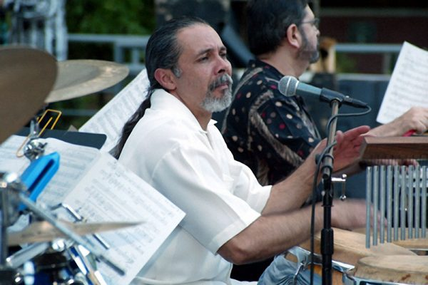 "Angel Rodriguez- congas, Victor Rendón- timbales ""Homenaje a Mongo Santamaria"" (Homage to Mongo Santamaria) Concert, June 16, 2003, Seuffert Bandshell, Woodhaven Queens, New York, photo credit Jerry Lacay."
