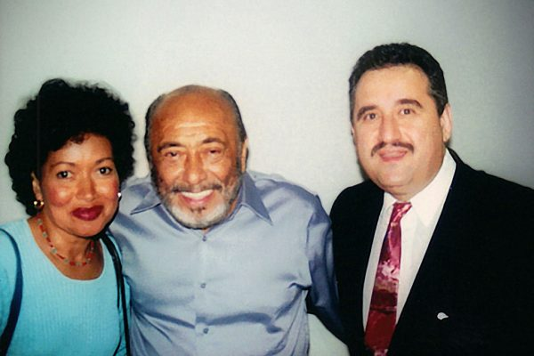 left to right: WBAI radio host: Nancy Rodriguez, Multi Grammy Award winner, Latin music icon, master pianist, Eddie Palmieri, Demetrios Kastaris. Flushing Town Hall, September 21, 2001, photo credit: Hilda Kastaris