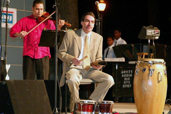 Alí Bello on violin, Dave Valentin on bongo bell, June 16, 2003, Seuffert Bandshell, Woodhaven Queens, New York (photo credit Jerry Lacay)