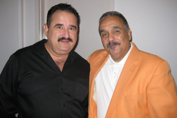 Left: Demetrios Kastaris, right Latin music icon, singer, trombonist, Willie Colon, at the Queens Theatre in the Park, Flushing, New York, October 2010