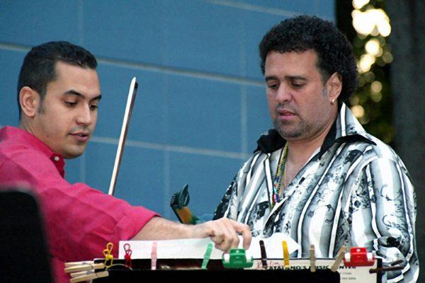 "Violinists Alí Bello & Alfredo de la Fé , ""Homenaje a Mongo Santamaria"" (Homage to Mongo Santamaria) Concert, June 16, 2003, Seuffert Bandshell, Woodhaven Queens, New York (photo credit Jerry Lacay)"