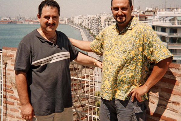 left: Demetrios, right, Yannis Economides, leader of Aroma Caribe, on top of the Lefko Pyrgo (White Tower) in Thessaloniki, Greece, August, 2004