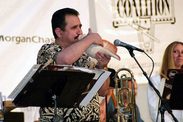Demetrios Kastaris plays a large conch shell, June 16, 2003, Seuffert Bandshell, Woodhaven Queens, New York (photo credit Jerry Lacay)