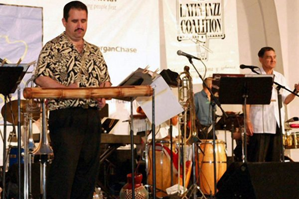 Demetrios Kastaris plays the rumba (cáscara part) on a customized hollow wooden cane (guadua) from South America , Seuffert Bandshell, Woodhaven Queens, New York (photo credit Jerry Lacay)