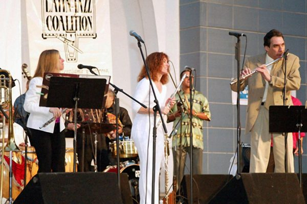 "Front row left to right: Connie Grossman, Andrea Brachfeld, Dave Valentin , in background Herman Olivera, ""Homenaje a Mongo Santamaria"" (Homage to Mongo Santamaria) Concert, June 16, 2003, Seuffert Bandshell, Woodhaven Queens, New York (photo credit Jerry Lacay)"